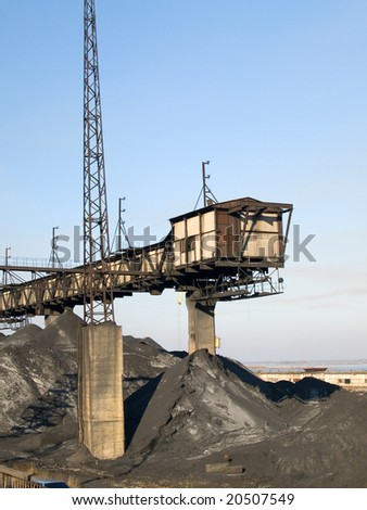 The coal mine and piles of coal - stock photo