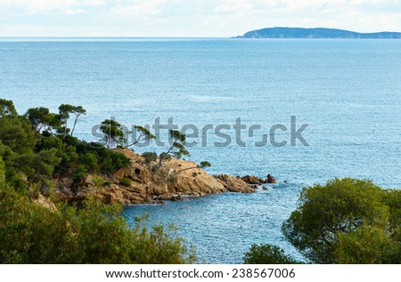 The coast of Mediterranean sea near the famous resort village of Le Lavandou, French Riviera, South France - stock photo