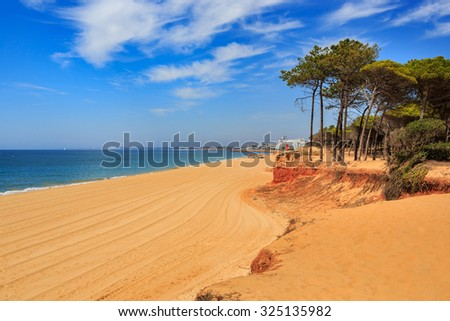 The coast of the Algarve in southern Portugal near Quarteira - stock photo
