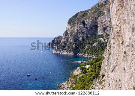 The coastline of the island of Capri, which is off Sorrentine peninsula in the Bay of Naples, Italy. - stock photo