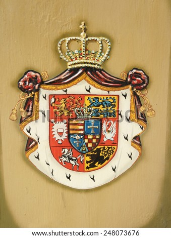 The coat of arms of the Grand Duchy Oldenburg painted on the metal - stock photo