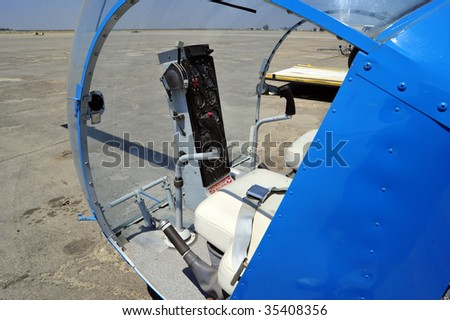 The cockpit of a small two-place helicopter