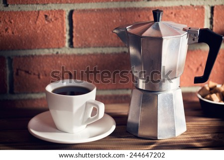 the coffee in mug and coffee maker - stock photo