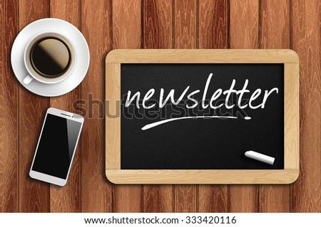 The coffee, phone  and chalkboard with word newsletter - stock photo