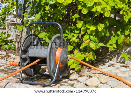 the coil for a hose in a garden - stock photo