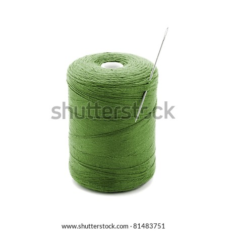 The coil of green thread with a needle, isolated on white. - stock photo