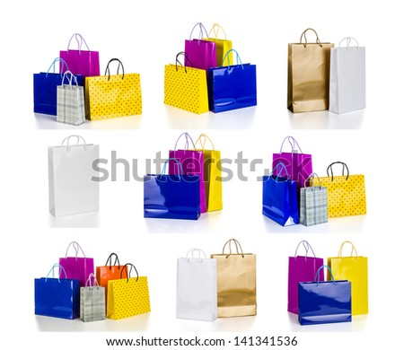 The collection of bright gift bags isolated on white background - stock photo