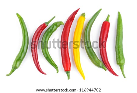The color chili peppers on a white background - stock photo
