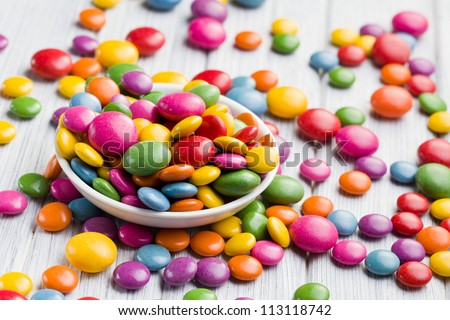 the colored candy in white bowl - stock photo