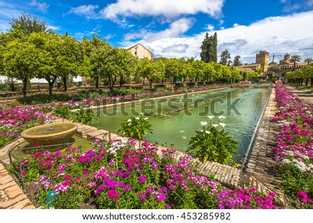 The colorful and blooming gardens in the spring of Alcazar de los Reyes Cristianos in Cordoba, Andalusia, Spain.