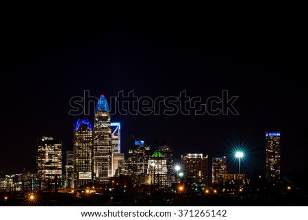 The colorful Charlotte, North Carolina skyline taken at night a week before the Super Bowl .  - stock photo