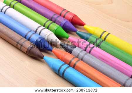 The colorful crayon on the wooden background - stock photo