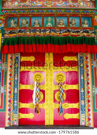 The colorful doors of a Tibetan Buddhist monastery.