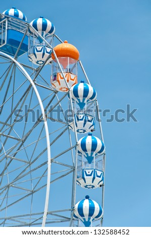 The colorful ferris wheel with blue sky