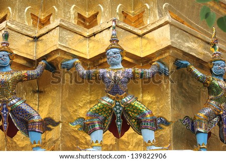 The colorful giant statues carrying the pagoda at Wat Pra Kaeo, Bangkok