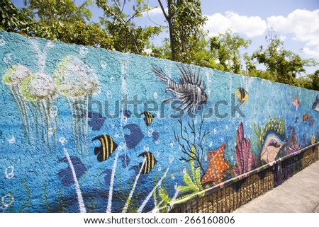 The colorful marine theme graffiti on a concrete wall in San Miguel town (Cozumel, Mexico). - stock photo
