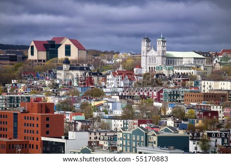 The colorful old city of St. John's, Newfoundland with its unique architecture.  The large building on the top left is the new art gallery and museum called 'The Rooms'. - stock photo