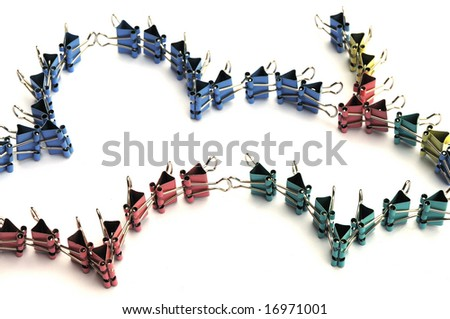 The colorful small iron clips linked as a flying bird wings.