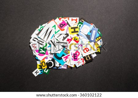 The colorful speech bubble in cut out magazine letters. - stock photo