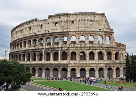 The Colosseum, famous ancient amphitheater in Rome, Italy. Unesco World Heritage site. - stock photo