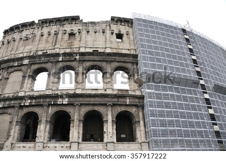 The Colosseum in Rome,Italy with Scaffolds - stock photo