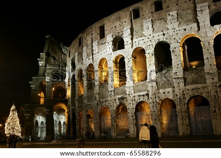 The Colosseum, originally the Flavian Amphitheatre with a christmas tree at night - stock photo