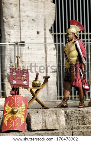 THE COLOSSEUM, ROME- AUGUST 17: A street performer dressed as a centurion performs for tourists, August 17, 2008 in Rome, Italy. - stock photo