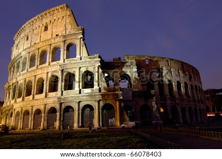 The Colosseum, the world famous landmark in Rome. Night view - stock photo