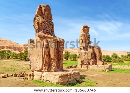 The Colossi of Memnon, two massive stone statues of Pharaoh Amenhotep III in Luxor, Egypt - stock photo