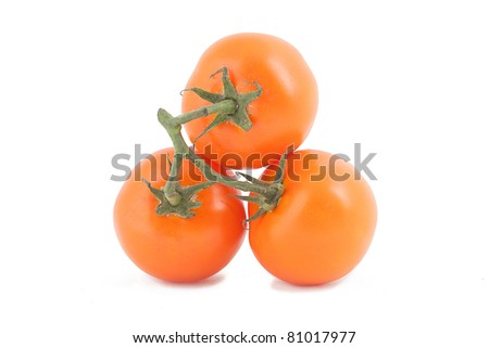 the combination of the three orange tomatoes on a white background - stock photo