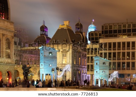 The comedie square during light festival in Lyon with fisherman's huts - stock photo