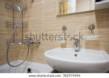 The compact bathroom is located in the hotel - stock photo