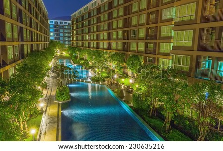 The complex is modern condominium with pool - stock photo