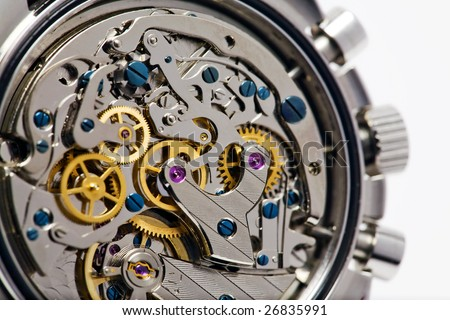 The complex movement of a modern wind-up watch - stock photo