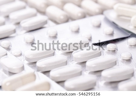 The composition capsules on a white background.