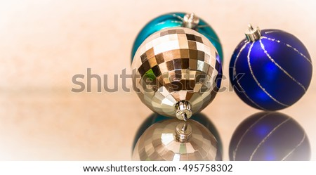 The composition of blue and silver Christmas balls. New Year's toys on a glass surface.