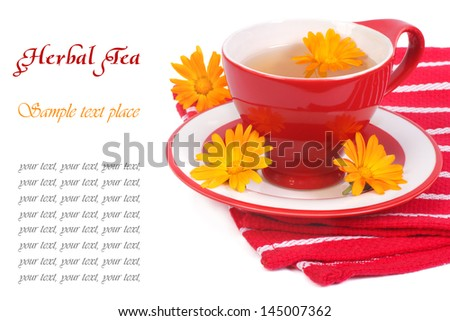 The composition of tea with calendula on a red napkin isolated on white background