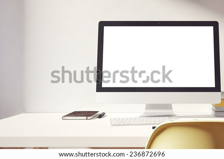 the computer is on the table in a bright interior - stock photo