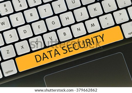 The computer keyboard button written word data security . - stock photo