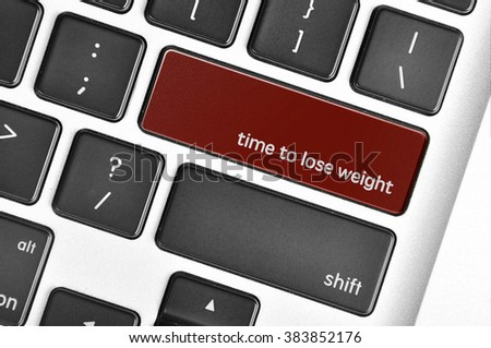 The computer keyboard button written word time to lose weight . - stock photo