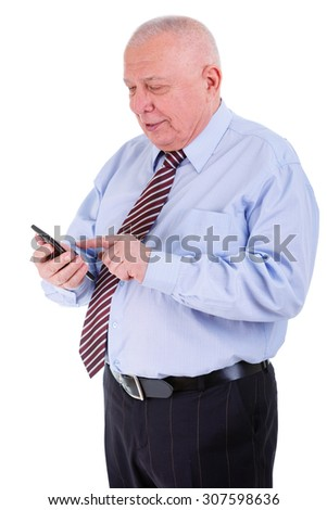 The concentrated old senior businessman in shirt and tie. Holding cell phone in hand and putting in number, Isolated, plain white background