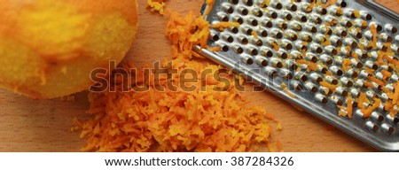 The concept of a healthy and beneficial food. Grated orange zest grated. Tasty and healthy. - stock photo