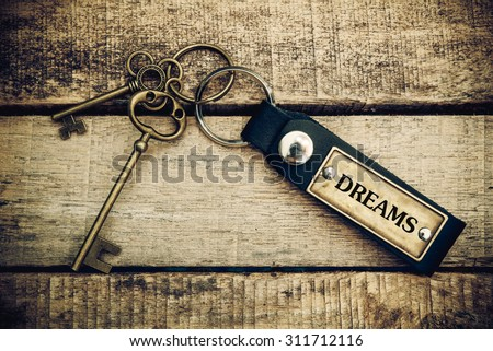 The concept of 'dreams' is translated by key and silver key chain - stock photo