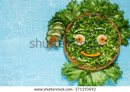 The concept of ecology, healthy food, preventing the spring avitaminosis - fresh green vegetables in the form of a smiling face. Symbol Earth Day - stock photo