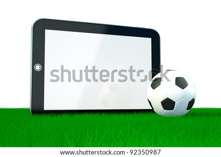 the concept of games on electronic devices, soccer ball with tablet pc - stock photo