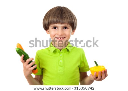 The concept of healthy eating. Happy child with fresh vegetables.     - stock photo