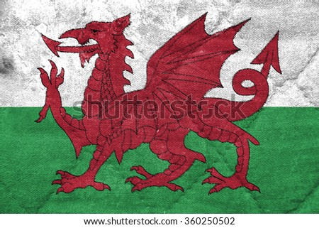 The concept of national flag on stitched canvas background: Wales - stock photo