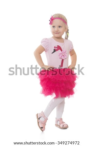 The concept of the celebration and happy childhood.Sweet, joyful , Caucasian little girl dressed in a pink dress -Isolated on white background - stock photo