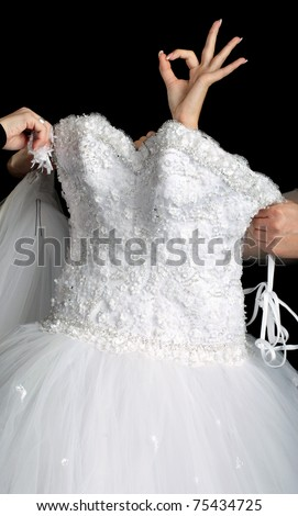 The concept of wedding dress and arm shows ok - stock photo