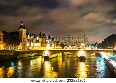 The Conciergerie building in Paris, France in the night